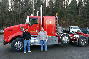 Men In Front Of a Truck